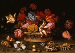 A basket of flowers with shells on a ledge