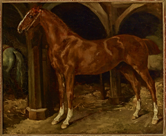 Chestnut horse in a stable