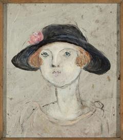 Głowa kobiety w czarnym kapeluszu