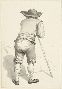 Man vooroverleunend op een stok, op de rug gezien