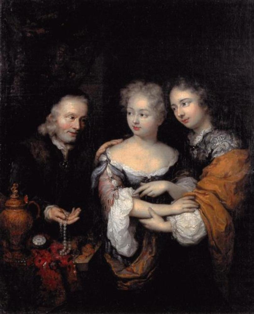 Old man offering a necklace to a young couple