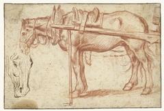 Paard voor een kar en een paardenhoofd