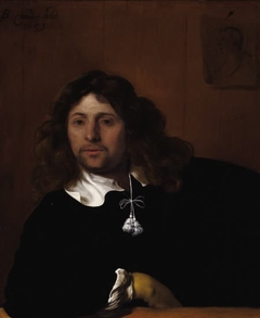 Portrait of a man leaning his arm on a ledge