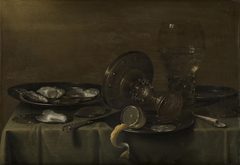 Still life with a silver tazza, rummer and oysters