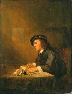 Young man sitting indoors, writing