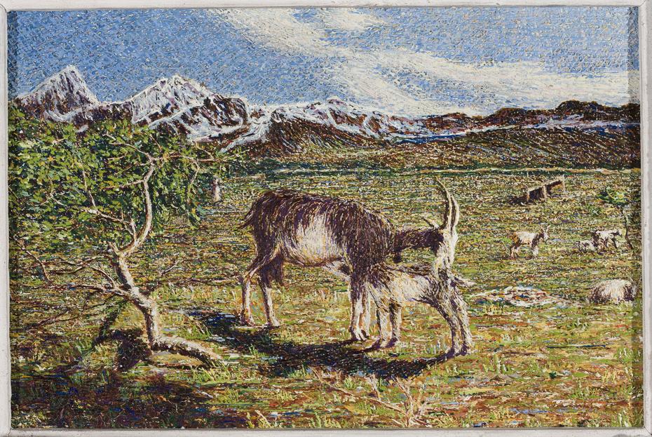 Goats against landscape