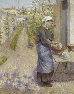 In the Garden at Pontoise:  A Young Woman Washing Dishes