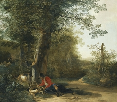 Peasant playing with his dog while resting at the margin of a wood