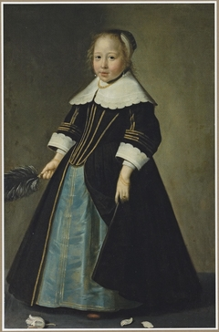 Portrait of a girl in a blue and black dress with gold trimming, with white lace collar