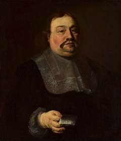 Portrait of a man holding a letter.