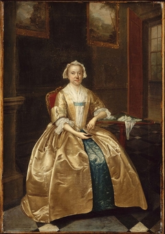 Portrait of a Woman Seated beside a Table