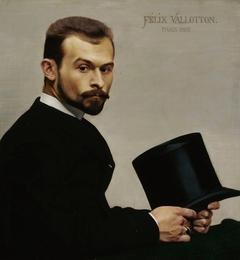 Portrait of Janiski holding his hat