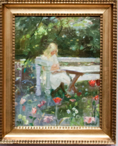 A girl in the garden in summertime