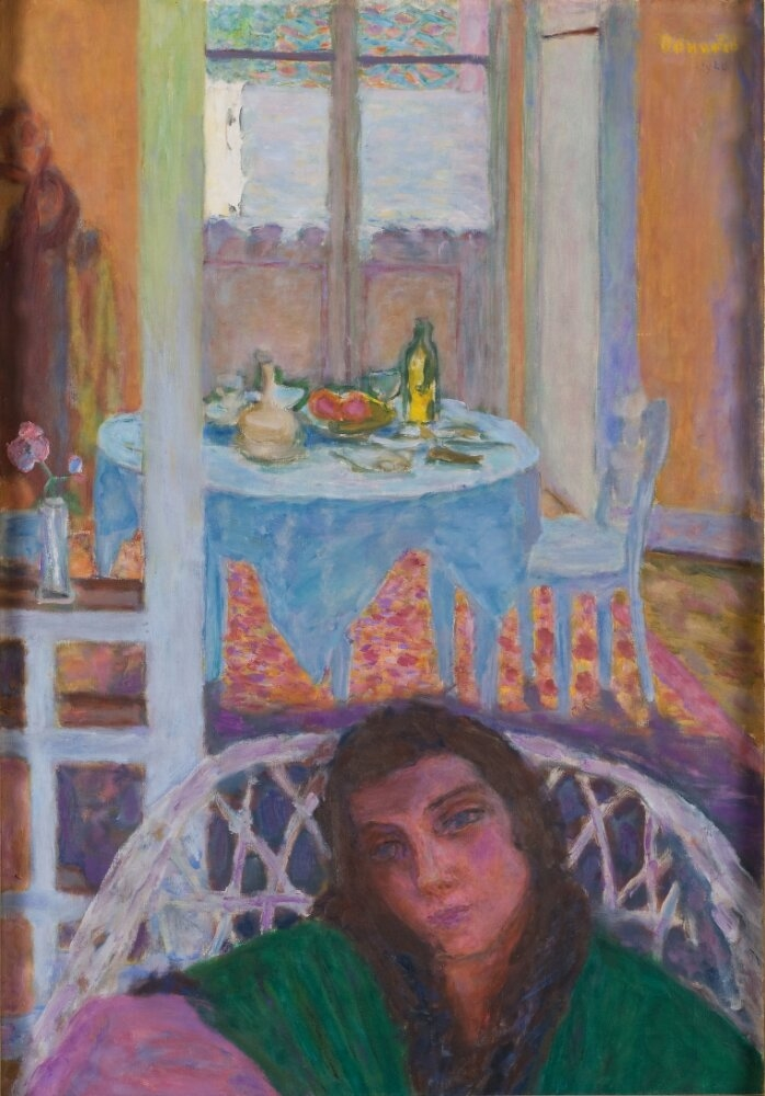 Interior with a Woman in a Wicker Chair