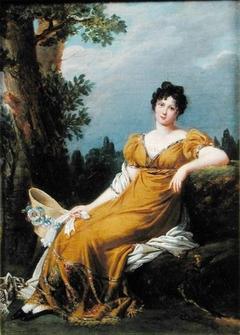 Portrait d'une femme assise dans un paysage
