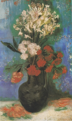 Vase of carnations and other flowers