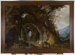 Berglandschap met reizigers bij een kapel