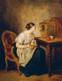 Junge Frau mit Vogelkäfig