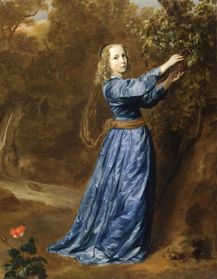 Portrait of a girl picking grapes