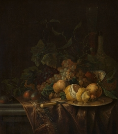 Still life with fruit, flute and a carboy