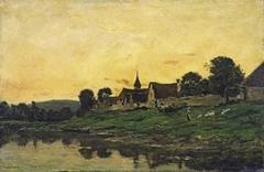 Village on a river, sunset