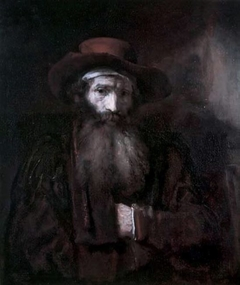 Half-length portrait of a man with beard and headscarf under his hat