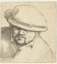 Hoofd van een man met een hoed op