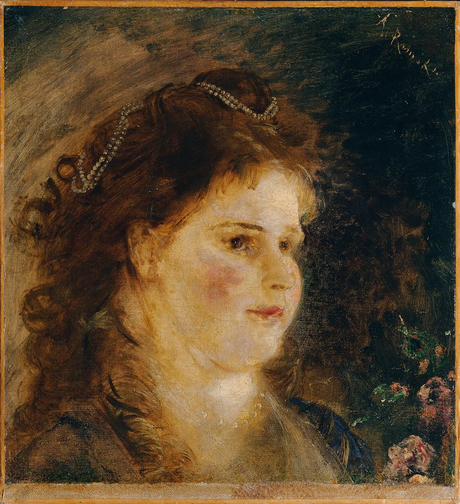 Mädchen mit Perlenkette im Haar
