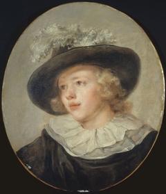 Portrait de jeune garçon avec un chapeau à plumes