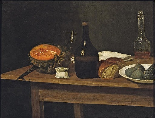 Two bottles, an empty wine glass, a knife, a slice of pumpkin, a half loaf of bread, a white napkin with figs and black grapes in a white porcelain bowl, all on a wooden table