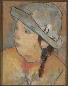Głowa dziewczynki w niebieskim kapeluszu