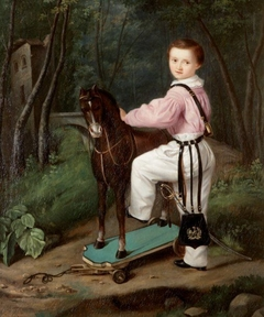 Portrait of a Child with a Toy Horse