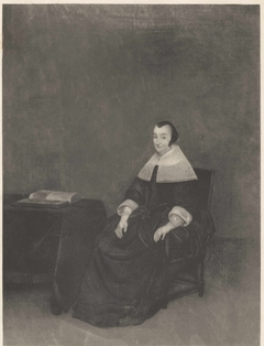 Portrait of a Lady seated in an Arm-Chair with a Book