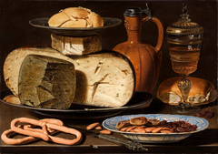 Still life with cheese, bread and drinking vessels