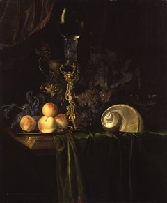 Still life with luxury vessels and fruits on a dark table cloth