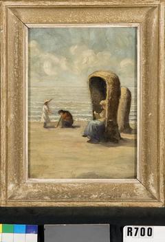 Vrouw en kinderen aan het strand