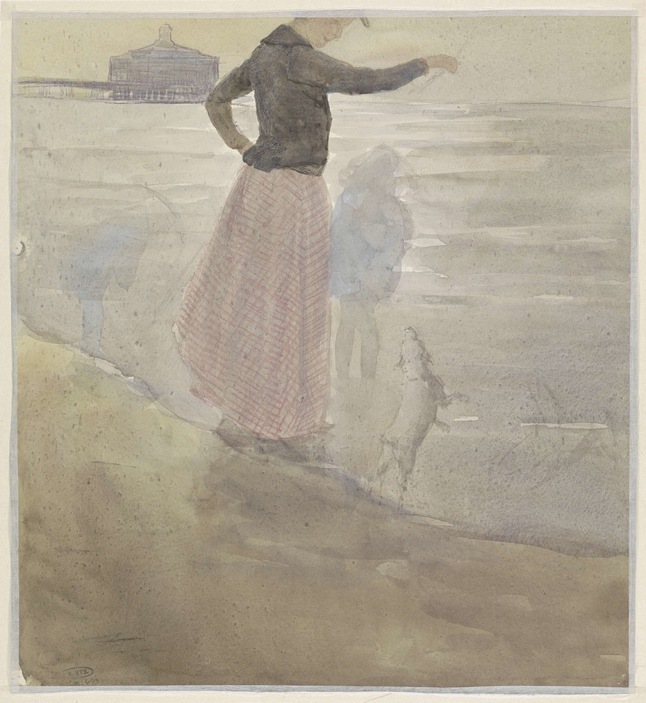 Vrouw met twee kinderen en een hondje aan het strand