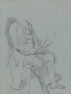 Zittende man met blad papier in de hand