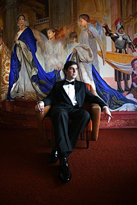Oscar Casares in front of his painting - panel Salve Regina