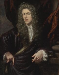 Portrait of a man holding his brocade robe shut