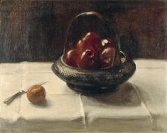 Rode appels in riet mandje