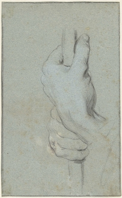 Studie van twee handen die een staf omklemmen