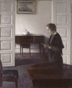 Interior with a Reading Lady