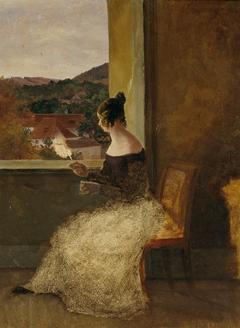 Dame am Fenster mit Spinnrocken