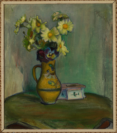 Flowers in a yellow pitcher