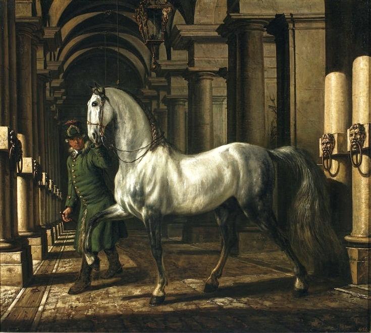 Groom leading a horse