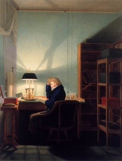 Man reading by lamplight