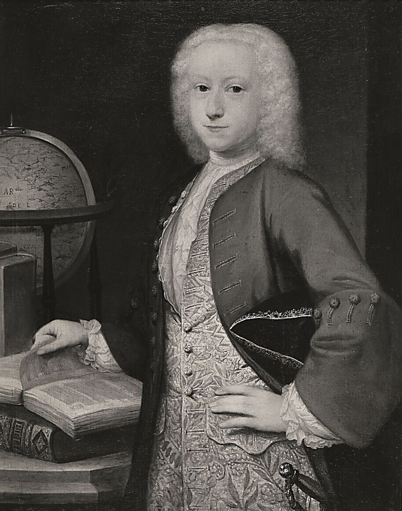 Portrait of a boy, standing next to a table with folios and a globe