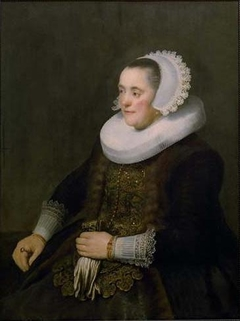 Portrait of a Woman holding Gloves