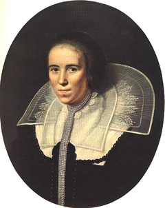 Portrait of a young woman with a pearl chain